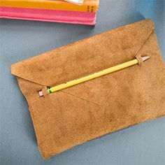 Get inspiration from Anthro to make a leather journal. Perfect gift! #sewing #clutch #diy