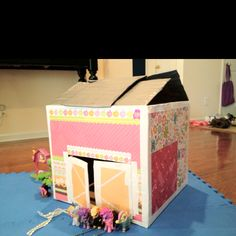 Pony Barn from cardboard box, scrapbook paper, glue strips, and duct tape