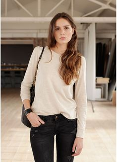 Simple. Long Sleeve tee, distressed jeans, black bag and chic black cuff. Natural hair and make up.