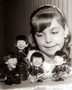 She adores her 1964 Remco Beatles dolls