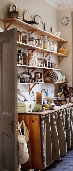 Low-cost solutions - Add height and practicality to your kitchen. Rows of shelving for your goods with a small skirted counter gives more storage