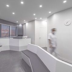 The white and grey walls of this dental clinic in Iran are shaped and angled to maximise the amount of light allowed into the interior. Read the full story at dezeen.com/tag/dentists #interiordesign #dentists