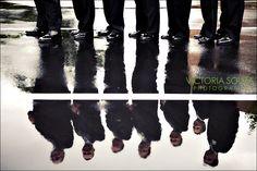 creative photo of groomsmen on a rainy wedding day!
