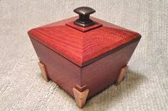 Another Asian style tapered-side box with a lift-off lid and interior tray. This box is made of Jatoba (South America) with oak splines, legs and interior tray. The box is about inches and. Small Wooden Boxes, Small Boxes, Wood Boxes, Woodworking Jewellery Box, Woodworking Box, Wooden Keepsake Box, Keepsake Boxes, Wooden Box Designs, Jewelry Box Plans