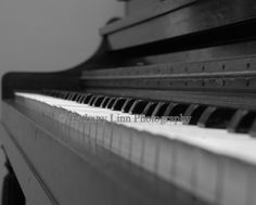Playing with perspective, our beautiful old can't-quite-be-tuned upright piano in black and white. www.bethanylinnphotography.com