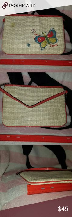Coach wristlet Coach wristlet never been used.  NWOT.  Material is woven straw like.  Very soft and feels nice.  Inside has a slip pocket. Coach Bags Clutches & Wristlets