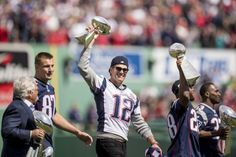 BOSTON, MA - APRIL 3: Tom Brady #12 of the New England Patriots holds the Super Bowl trophy alongside Owner Robert Kraft, Rob Gronkowski #87, James White #28, and Dion Lewis #33 during a pre-game ceremony before the Boston Red Sox home opener against the Pittsburgh Pirates on April 3, 2017 at Fenway Park in Boston, Massachusetts. (Photo by Billie Weiss/Boston Red Sox/Getty Images)