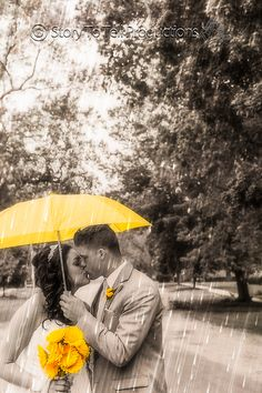 They say rain on your wedding day means good luck! Well it certainly didn't ruin their day! http://storytotell.me/blog/mr-mrs-ault/ Wedding Photography