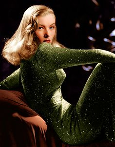 Veronica Lake in a glittering green gown, 1940s./I love the minimal eye & strong lip