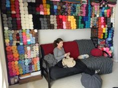 This is great.  She took cubes that she bought at WalMart and her husband attached them to the wall for yarn storage.  My someday craft room.: