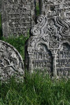 18th century gravestones at the old Jewish cemetery in Medzhybizh Stock Photo