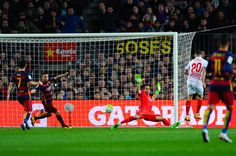 Victor Machin 'Vitolo' of Sevilla FC scores the opening goal past Claudio Bravo of FC Barcelona during the La Liga match between FC Barcelona and Sevilla FC at Camp Nou on February 28, 2016 in Barcelona