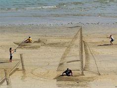 Velejando na areia.