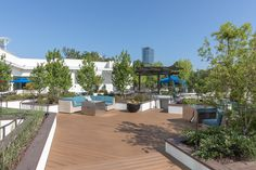 The welcoming entrance to the rooftop deck is planted with young trees and carefully-selected arrangements.