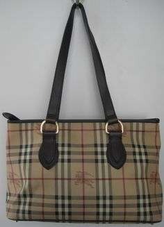Burberry medium Haymarket Check tote. Traditional 'haymarket' check tote with double chocolate leather straps. Features top zip & four feet. Fabric lining with 1 zip & 2 slip pockets. $499.50