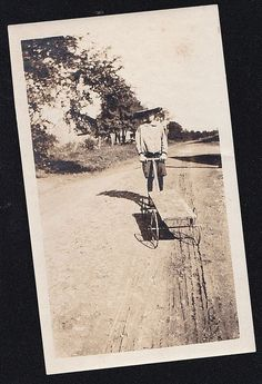 Vintage Antique Photograph Young Boy in Huge Hat Pulling Wagon on Dirt Road