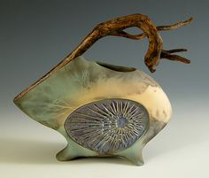 "Jan Jacque | "" za zing"" (Artist description: ""Za Zing""  Ceramic Sculpture  Created by Jan Jacque  This vessel is a balance of rich textures, colors and form. A slab built clay form is married with a unique branch. The inset texture is glazed with several layers creating a depth of color. The piece is electric fired and pit fired.)"