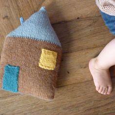 A knitted house cushion.