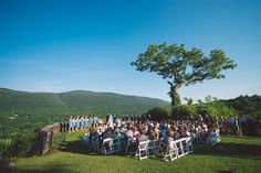 The ceremony overlooked Battenkill Valley.  Venue:Hildene The Lincoln Family Home  Event Planner: Nicole Brock  Dress Designer:L'Fay Bridal  Hair and Makeup Artist: Fringes Salon  Groom and Groomsmen Attire: Berel & Co. andBonobos  Floral Designer:Lily of the Valley