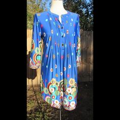 Stunning retro print tunic top This tunic top has bright, bold colors with an adorable retro like print. NWT! Material is 95% polyester and 5% spandex. Reborn Tops Tunics