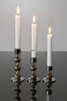 Asmussen Hamlet Design candlesticks and candleholders holders in metal for sale. Buy at Danish Porcelain House.
