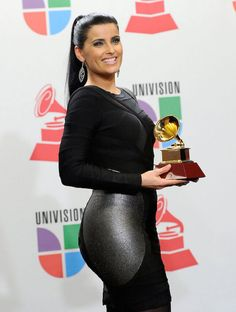 Canadian singer, Nelly Furtado with her Grammy Award...