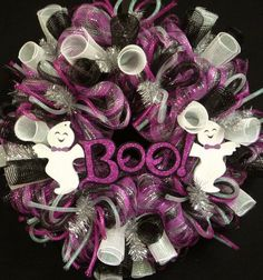 """This eye catching wreath will just pop with color on your front door for Halloween this year!  Made on a poly mesh work frame--it has lots of black / hot pink / silver deco mesh, flex tubing and waffle ribbon.  Add a really cute """"BOO"""" with ghosts in the center"""