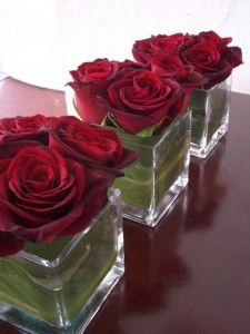 Short Red Rose Valentine Centerpieces - Love the leaf lined vase! Low centerpieces are perfect for a dinner party so guests can see each other. Read the post for more Valentine's Day Party Decorations