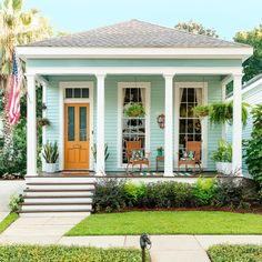 Get inspo for your own home by checking out Curb Appeal in each iYou can find Hgtv magazine and . House Paint Exterior, Exterior House Colors, Exterior Design, Beach Cottage Exterior, Blue Siding, Cottage Homes, Beach Cottages, House Painting, My Dream Home