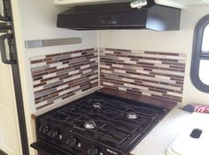 If you're looking for a way to beautify your RV kitchen without adding extra weight or spending a lot of money, Smart Tiles may be the answer.