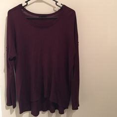 Long sleeve top Comfortable long sleeve top. Long enough to to cover my bottom. The color is somewhere between a dark maroon and a deep purple- so very pretty especially for the fall. There is a small hole on the back, right shoulder. A simple piece and staple from my closet. H&M Tops Tees - Long Sleeve