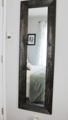 diy mirror...frame a cheap mirror and paint...yellow for our bedroom with really big trim??
