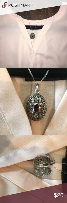 Locket Necklace silver oval locket with a red stone in the middle! Jewelry Necklaces