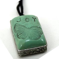 DIY tutorial on how to stamp Polymer Clay to make beautiful jewelry pendants.