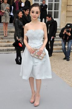Dior Fall 2012: The New New Look: PARIS, FRANCE - MARCH 02:  Peng Lin attends the Christian Dior Ready-To-Wear Fall/Winter 2012 show as part of Paris Fashion Week at Musee Rodin on March 2, 2012 in Paris, France.  (Photo by Pascal Le Segretain/Getty Images)