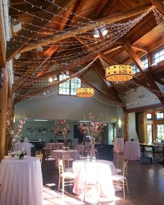 Fans of twinkle lights span the ceiling in Kirby Horton Hall, The Doris Duke Center, Duke Gardens.  Event Planning: Gather Together Events.  Flowers: Tre Bella.  Lighting: Get Lit, Special Event Lighting.
