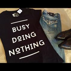 BACK BY DEMANDBUSY DOING NOTHING TEE ☺️ Weekend Wear!!☺️ Fun Celeb Style Graphic Tee. Great to pair with sweats at home or jeans out and about... Make a statement without saying a word!! Marked as an XL but fits more like a L to me. ❣MORE SIZES AVAILABLE❣Please let me know if u want one & I'll make u a new listing 2 Monkeys Tops Tees - Short Sleeve