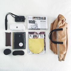 All the #necessities for a flight with no kids | @cerihooverbags | #carryon #pack #runwayreading #snacksack #rosebud #leica #cameramanual #nocomputersoimforcedtoreadmycameramanual