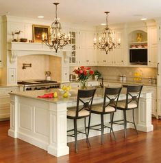 Definitely want a big kitchen island.  Love this cream color.  Love the mantel over the stove hutch too! Love the open floor plan and what looks like natural light seeping in.  Great color wood floors.