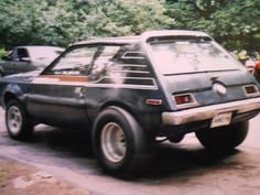 amc gremlin dark green we didn't have those wheels thou lol this looks like the one my dad had and then gave to me and could keep up with those small trucks 4 wheel driving That was my truck Amc Gremlin, Bike Engine, Big Trucks, Small Trucks, American Motors, Car Advertising, Unique Cars, Gremlins, All Cars