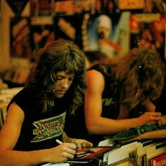 Lars Ulrich & James Hetfield signing vinyl and denim jackets at the Record Vault before the final show of the Kill 'Em All for One tour with Raven - Photo by Wayne Vanderkuil