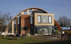 Arched eco-house. Eco friendly by not just being energy efficient but uses salvaged materials, reducing carbon footprint