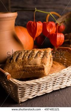 Fresh sweet strudel on a basket with a red physalis