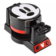 Mickey Mouse makes a lasting impression with the help of this double-sided waffle maker. Simply pour batter (not included) over the Mickey-shaped plates, lock the lid, and enjoy a fun Disney twist on a breakfast staple with Mickey Mouse waffles. Mickey Waffle Maker, Disney Mickey Mouse, Minnie Mouse, Waffles, Disney Visa, Estilo Disney, Cooking Appliances, Kitchen Appliances, Disney Sketches