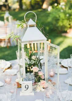 Filled with candles, flowers, or a combination of the two, lanterns can be used to create a charming centerpiece. We love the old-world vibe they bring to a table.