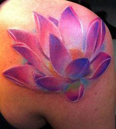 Pink shoulder lotus flower tattoo