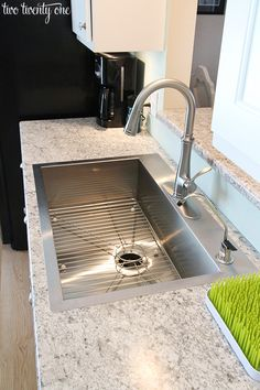 Love this sink! Under-mount sinks can get grimy underneath. The edge of this sink is really thin and lays nicely against the counter