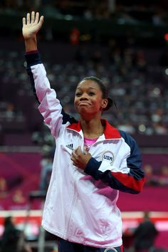 Gabrielle Douglas of the United States waves to the crowd after Douglas wins the gold medal in the Artistic Gymnastics Women's Individual All-Around final on Day 6 of the London 2012 Olympic Games at North Greenwich Arena on August 2, 2012 in London, England.