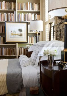This unique bookshelf styling idea involves turning your books backward in the bookshelf -- spines in -- for a monochrome and slightly mysterious look.