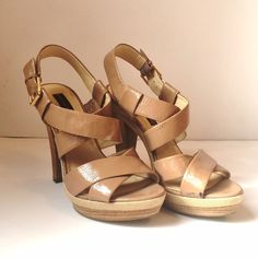 Steve Madden Tan Sandal Heels Faux patent in a earthy tan color. Strappy front with adjustable ankle buckle. Scuff and wear as seen in photo. No trades. Generous discount with bundle. Steven by Steve Madden Shoes Platforms